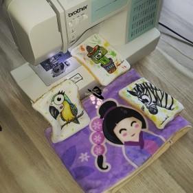 Lingettes lavables avec les coupons de Marion-nette et le tour de cou avec le coupon de Nidillus